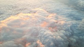 Ray of light glow on white cumulonimbus cloud. Light reflect from white Cumulonimbus cloud on the high altitude , view from air plane Stock Images