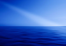 Ray of light in ocean abstraction Stock Photos