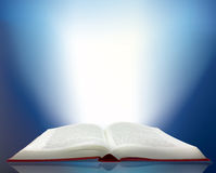 Ray of light shining from a book Stock Images