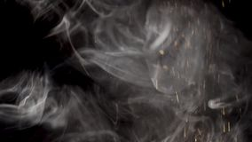 A ray of light with smoke and particles of gold.  stock video footage