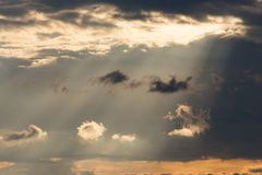 Ray light of sun through cloud. On dramatic sky, nature background Stock Photo