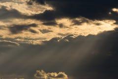 Ray light of sun through cloud. On dramatic sky, nature background Stock Photos