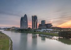 Beautiful sunset near the river. Ray of light during sunset near the river and building at Putrajaya Royalty Free Stock Photography
