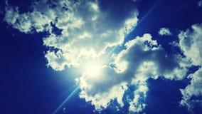 Ray of light. Sunshine clouds sky Stock Photos