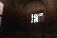 A ray of light through the window. The basement of an old fortress Stock Images