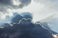 Ray of lights sunbeams break through thick clouds Stock Photo