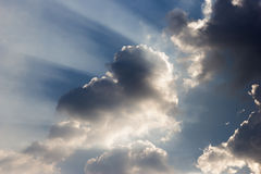 Ray of lights sunbeams break through thick clouds Royalty Free Stock Photos