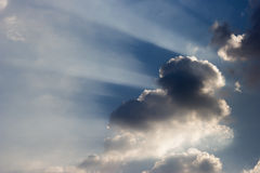 Ray of lights sunbeams break through thick clouds Stock Photos