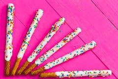 Ray pattern of white chocolate pretzel sticks Royalty Free Stock Photos