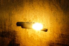 A ray of sun coming through the wooden shutters. Close up, selective focus. Vintage background royalty free stock images