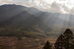 Ray of sun light through the clouds in Bumthang valley,Bhutan stock photos