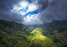 Ray of sun light through clouds. Rice terraces in Philippines Royalty Free Stock Photography