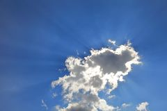 Beautiful ray of sun light shine through the cloud with silver lining. Ray of sun light shine through the cloud royalty free stock image