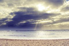 Ray of sun over the beach. At Kauai, Hawaii with cloudy sky Royalty Free Stock Photography