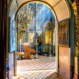 Ray of sunlight falls on iconostasis in othodox church. Stock Images