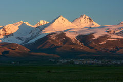 The ray of sunrise in snow-capped mountain of Aragats Stock Photo