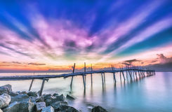 Ray sunrise on a wooden bridge Royalty Free Stock Photo