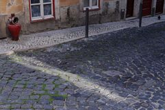 Ray of sunshine and cobblestone Stock Photography