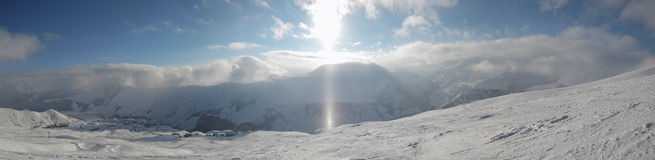 Ray of sunshine winter. View from mountain peak winter Ray of sunshine Stock Image