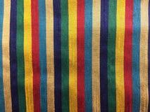 Raya del color en tela Foto de archivo