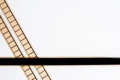 rayas de la película de cine de 35 milímetros en el fondo blanco Imágenes de archivo libres de regalías