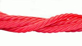 Rayas torcidas regaliz rojo del caramelo Fotos de archivo libres de regalías