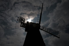 Rayleigh Windmill in Silhouette. The nineteenth century windmill in Rayleigh, Essex, England, silhouetted as the sun peeks through broken clouds Royalty Free Stock Photos