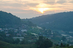 Raylight sunset landscape with village home at the mountain view in Doi Mon Jam, High mountain in Chiang Mai Province, Thailand Stock Photo