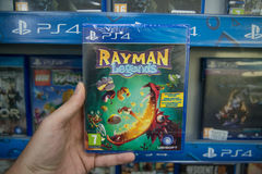 Rayman legends. Bratislava, Slovakia, circa april 2017: Man holding Rayman legends videogame on Sony Playstation 4 console in store Stock Photo
