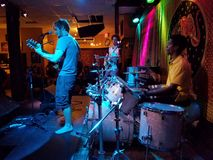 Raymond Brown and Band plays music indoors with cool lighting. Honolulu - June 7, 2017: Raymond Brown and Band plays music indoors with cool lighting at Hawaiian stock images