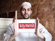 Raymond Group logo. Logo of Raymond Group on samsung tablet holded by arab muslim man. Raymond Group is an Indian branded fabric and fashion retailer. It Stock Images