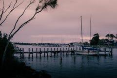 Raymond island Jetty. With Paynesville across the lake Royalty Free Stock Photo