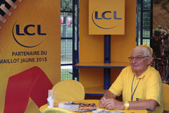 Raymond Poulidor in the village. PAU, FRANCE, July 15, 2015 : Old french champion, Raymond Poulidor, in the Village Depart of the Tour de France cyclist race Royalty Free Stock Photo