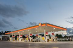 Rayong, Rayong /Thailand - June 17, 2018: Shell gas station. Blue sky background during sunset. Royal Dutch Shell sold its Australian Shell retail operations to stock photography