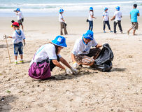 Rayong,Thailand: September 15 2012. Unidentified People cleaning Royalty Free Stock Photo