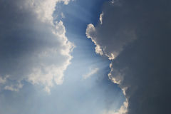 Rays behind clouds 1. Sun rays comes out from the clouds Stock Photos