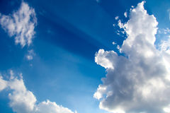 Rays and clouds Stock Images