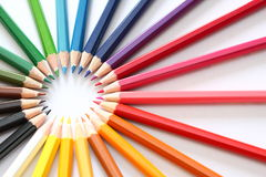 Rays of color pencils. Multicolor pencils forming a color circle isolated on white background royalty free stock photo