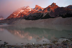 The rays of dawn over the mountain lake. Stock Image