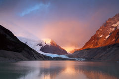 The rays of dawn over the mountain lake. Stock Photo