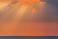 Rays of evening sun over sea Stock Photo
