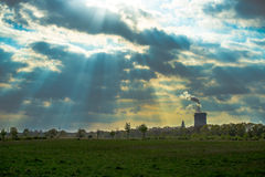 Rays in the industrial zone near Cologne. Steam power plant behind a wall of light Stock Image