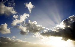 Rays of light. Bright rays of sunlight beam out in dramatic sky Royalty Free Stock Photos