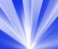 Rays of Light. Burst of white light rays on a blue background Royalty Free Stock Photography
