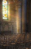 Rays of light. Through stained glass in a church Stock Photography
