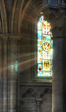 Rays of light. Through stained glass in a church Royalty Free Stock Photography