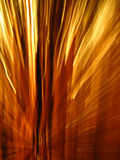 Rays of Light. Orange, Red, and Yellow rays of light fill this image with energy Stock Photography