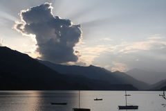 Rays of Light Above Boats in Lake Pokhara, Nepal Royalty Free Stock Photography