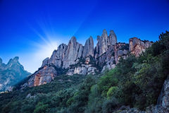 Rays of light behind Monserrat Royalty Free Stock Photos