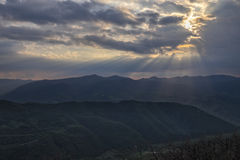 Rays of light in the clouds on Apennines, Umbria, Italy. Rays of light in the clouds after a storm on Apennines, Umbria, Italy Royalty Free Stock Image